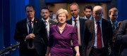 Theresa May flanked by advisers at the Conservative Party conference.