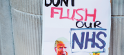 A 'protect the NHS' sign featuring Donald Trump