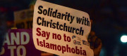 A man holds up a sign in solidarity with victims of the terror attack in Christchurch, New Zealand