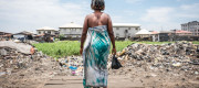 37 year old Modinatu Sofola looks out into the new apartments from her home in the slum of Ajeromi Ifelodun in Lagos, Nigeria - September 2016