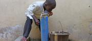 Ali Audu drinking water in a UN-run tranist centre in the north-eastern city of Maiduguri, Nigeria