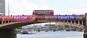 Amnesty International banners hang from Vauxhall Bridge in London