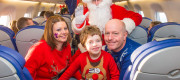 Dawn, Ben and Neil Bayliss on board the flight with Santa