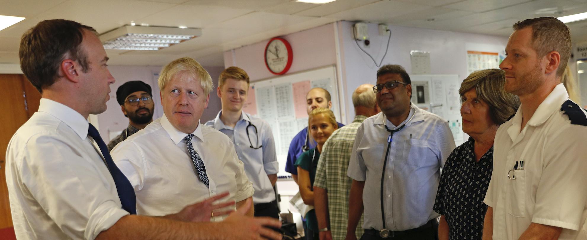 Matt Hancock and Boris Johnson visit an NHS hospital.