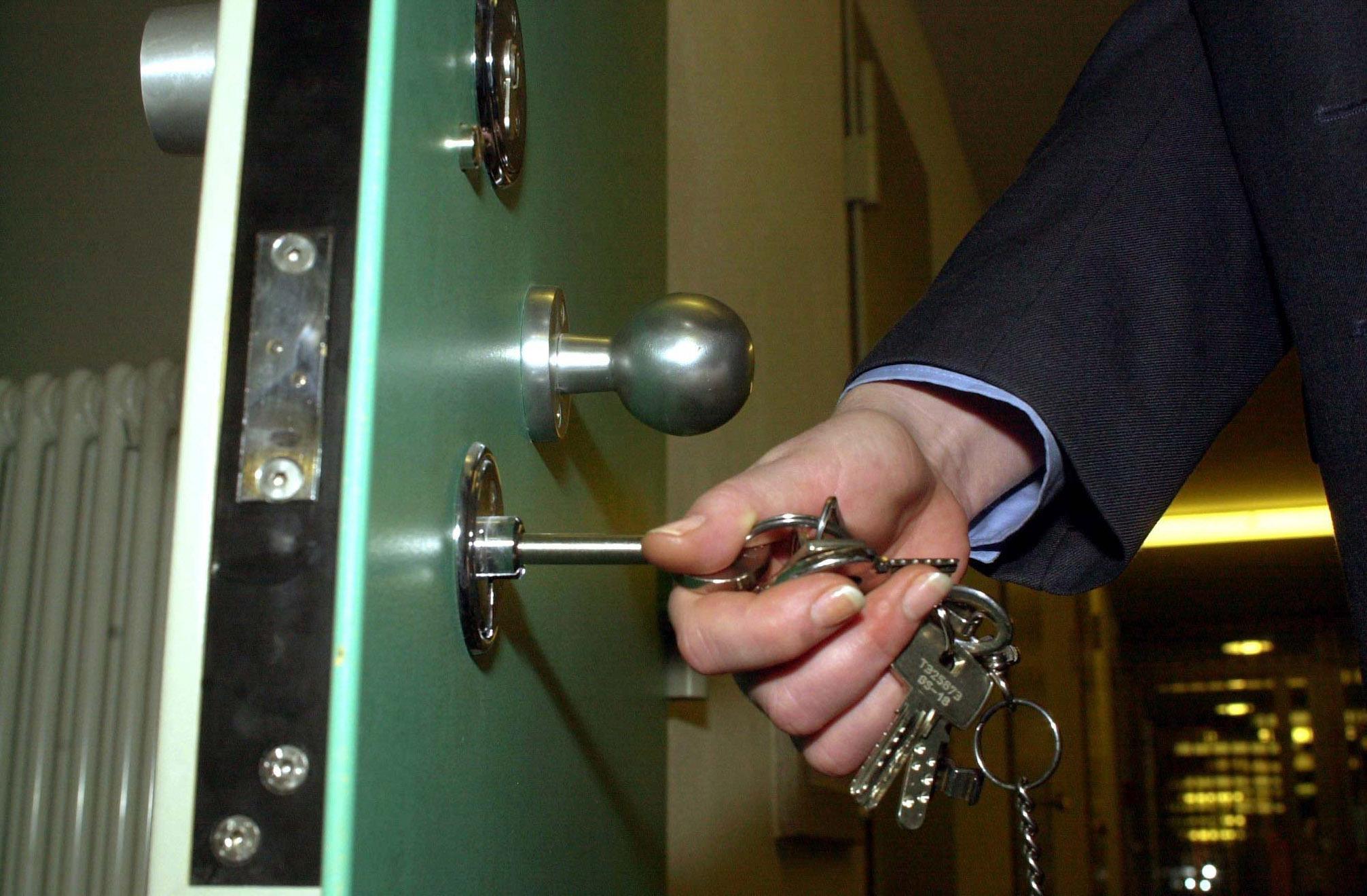 An officer closes a prison door