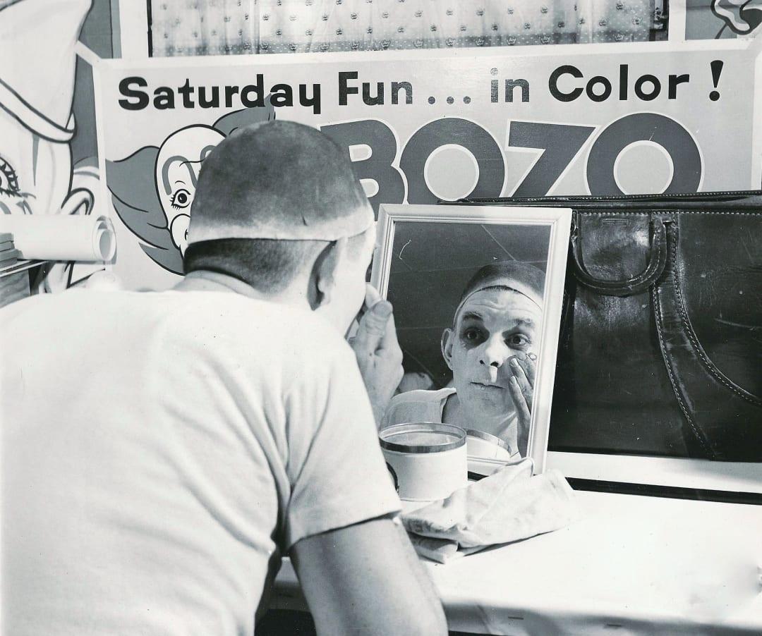 Bob McNea puts on clown makeup June 1961