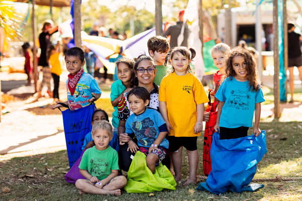 Cable Beach Primary School Pre-primary students and Aboriginal and Islander Education Officer, Shanice Flemming.