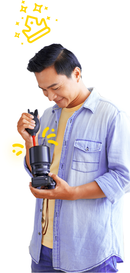 Man cleaning a lens