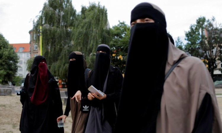A crime or a right? Some Danish Muslims to defy face veil ban
