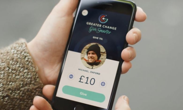 Homeless people in Oxford wearing QR codes to encourage cashless donations