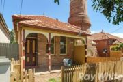 Historic Marrickville cottages with towering sewer vent on the market