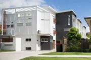 Brisbane's backyards emerge victorious over townhouses but for how long?