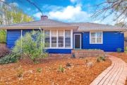The prettiest street in Narrabundah: 1950s weatherboard cottage snapped up at auction