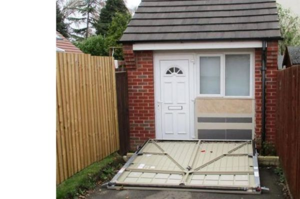 Uk Couple Fined After Hiding Unauthorised House Behind Fake Garage Door