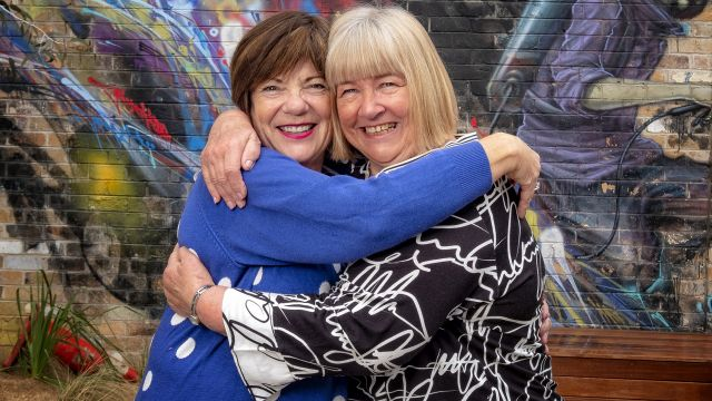 What friends are for: Best mates Jan and Jan buy next door to each other