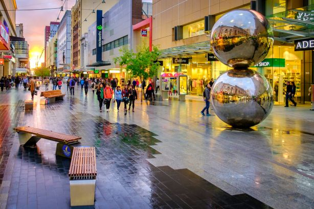 People walking along the Rundle Mall in Adelaide CBD at sunset, viewing towards West. Rundle Mall is the premier shopping area of South Australia