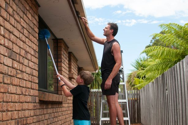 Father and son preparing property for sale