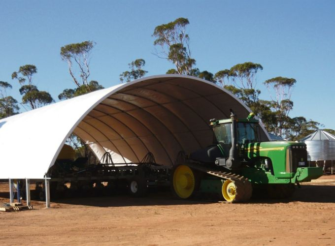 A John Deere 9400T entering a DomeShelter.