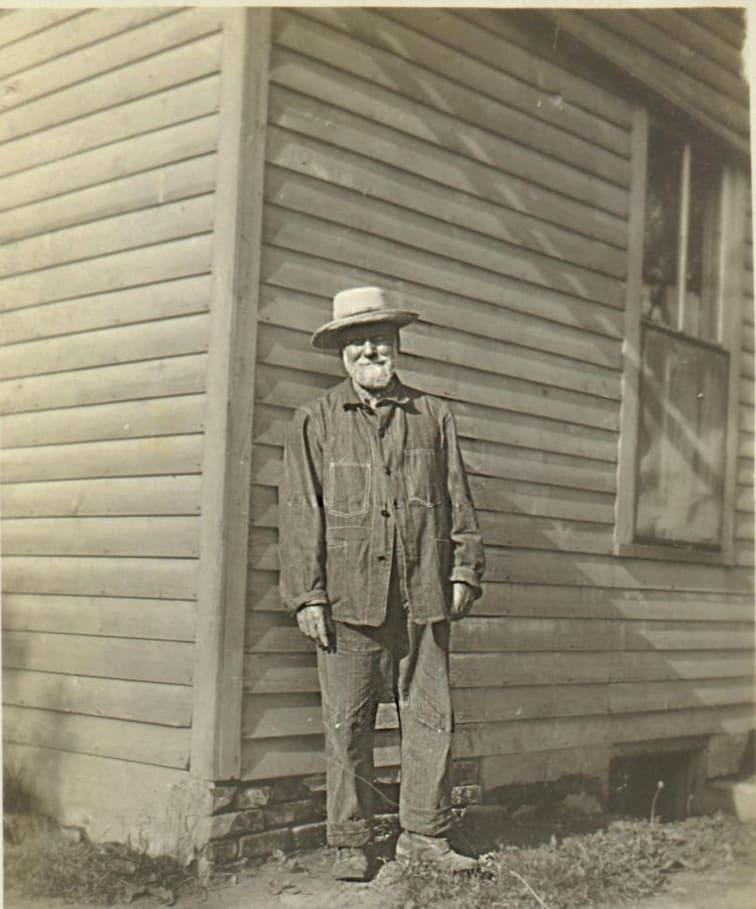 My great great grandfather, William Cornall, standing in front of a structure