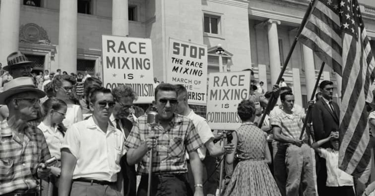 1960-era protestors protesting mixed-race marriages
