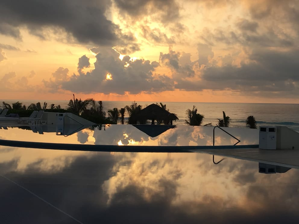 Cancun infinity pool at sunset