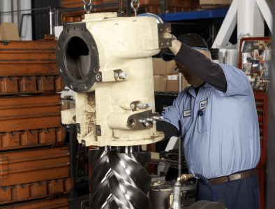 factory worker fixing an airend
