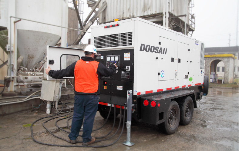 Large generator working at industrial factory