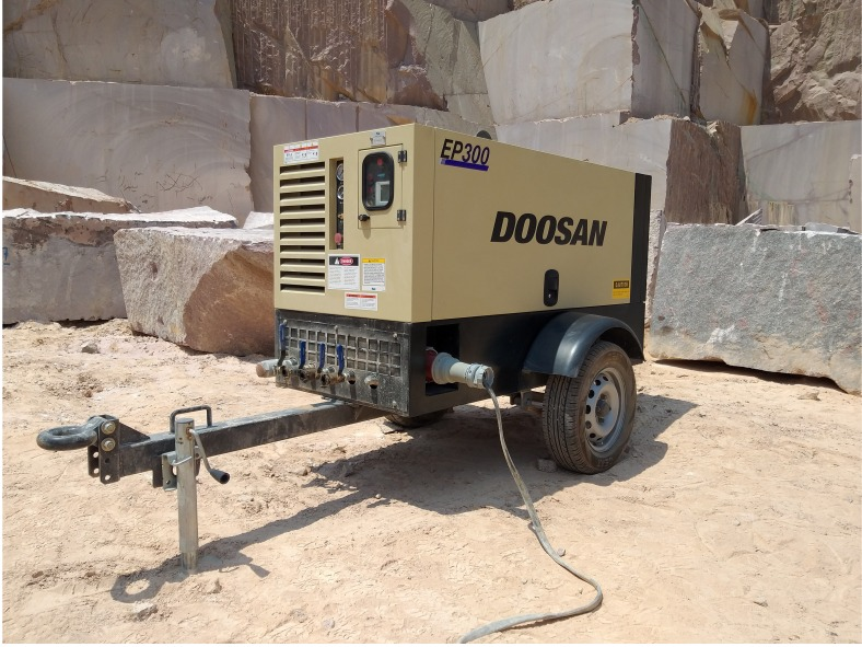 electric compressor in rock quarry