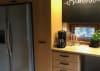 Keittiön ovien hionta uudelleen lakkausta varten