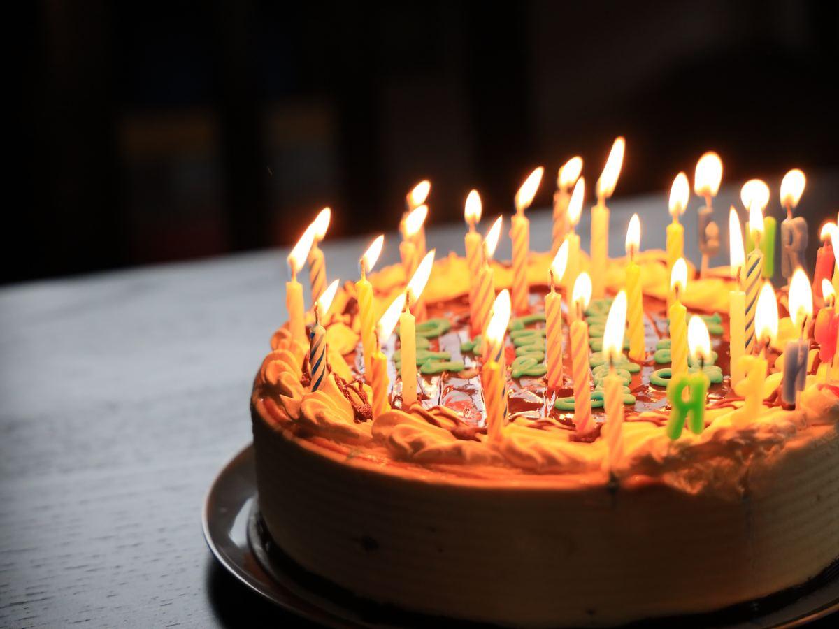 burning candles on brown cake
