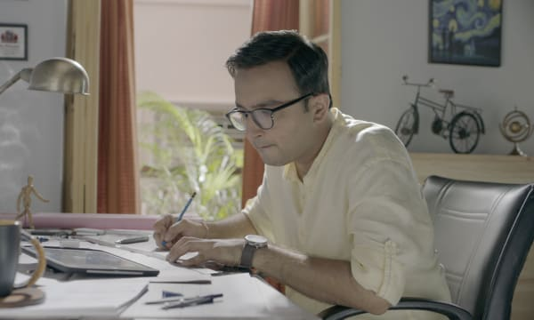 Young engineer at his desk working