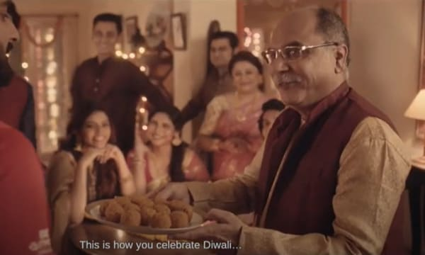 Indian family welcoming an Exide BatMobile service person to partake in Diwali celebrations