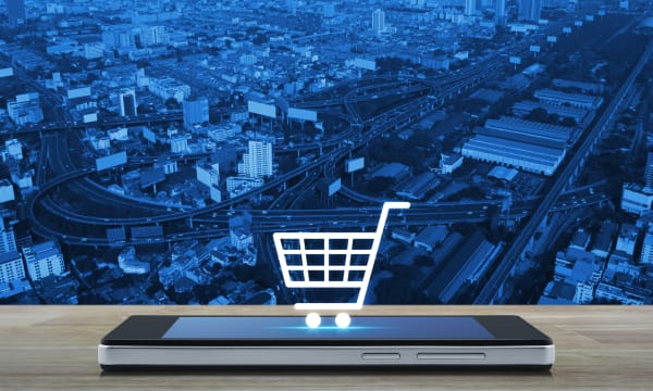 virtual shopping cart placed on mobile phone