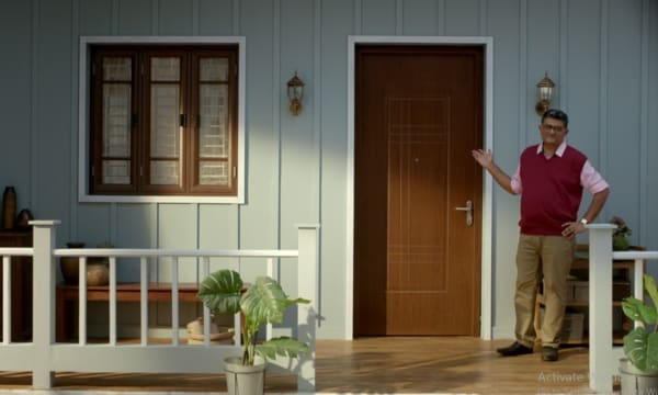 Man pointing towards a strong and durable Tata Steel door