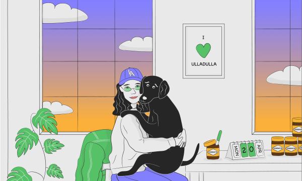 Girl hugging her dog while eating