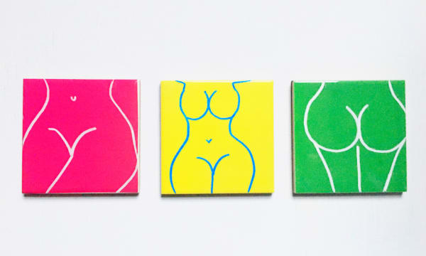 3 square illustrations of women's bodies on a wall.