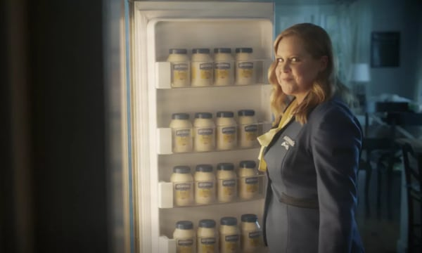 woman in front of open refrigerator filled with Hellmanns mayonaise