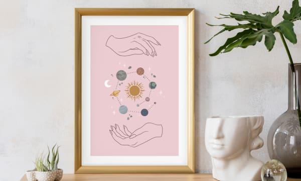 Framed illustration of hands holding the solar system