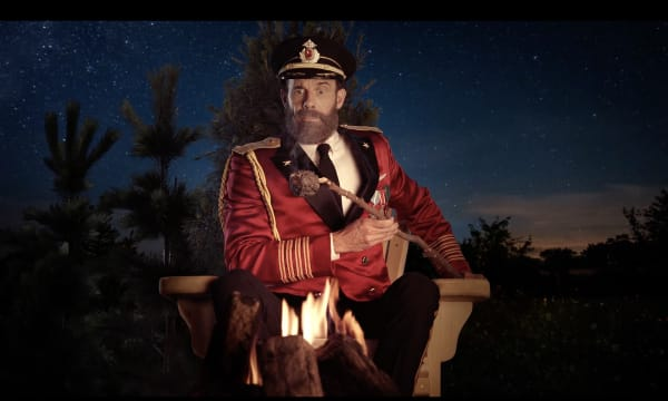 Captain Obvious roasting a marshmallow over a campfire. Background is a desert scene at dusk.