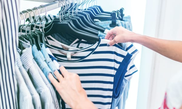 blue and white striped T-Shirts on a hatstand