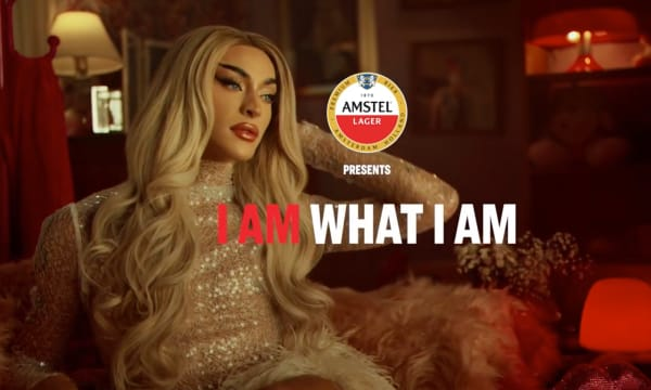 man with long hair and lipstick, Amstel logo