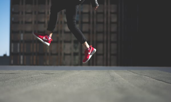 Red sneakers jumping