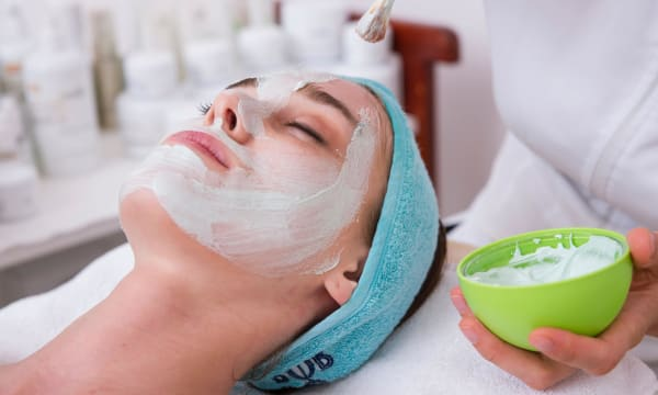 Image of self-care - woman undergoing a facial