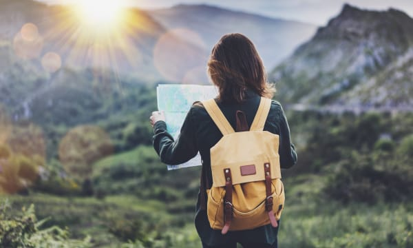 Woman on mountain with map