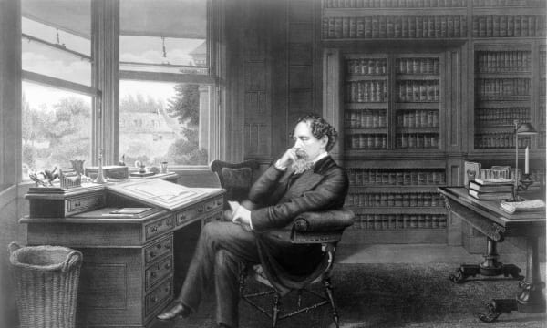 Charles dickens at publwriting desk