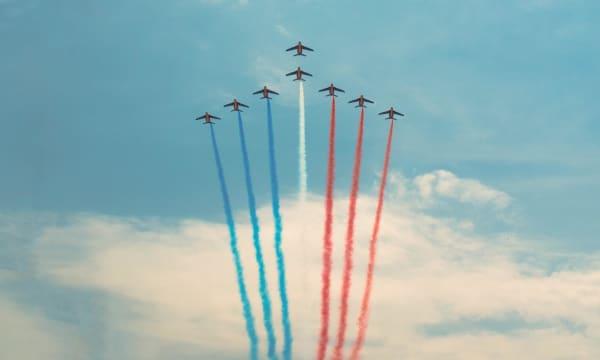 Formation flying against blue sky