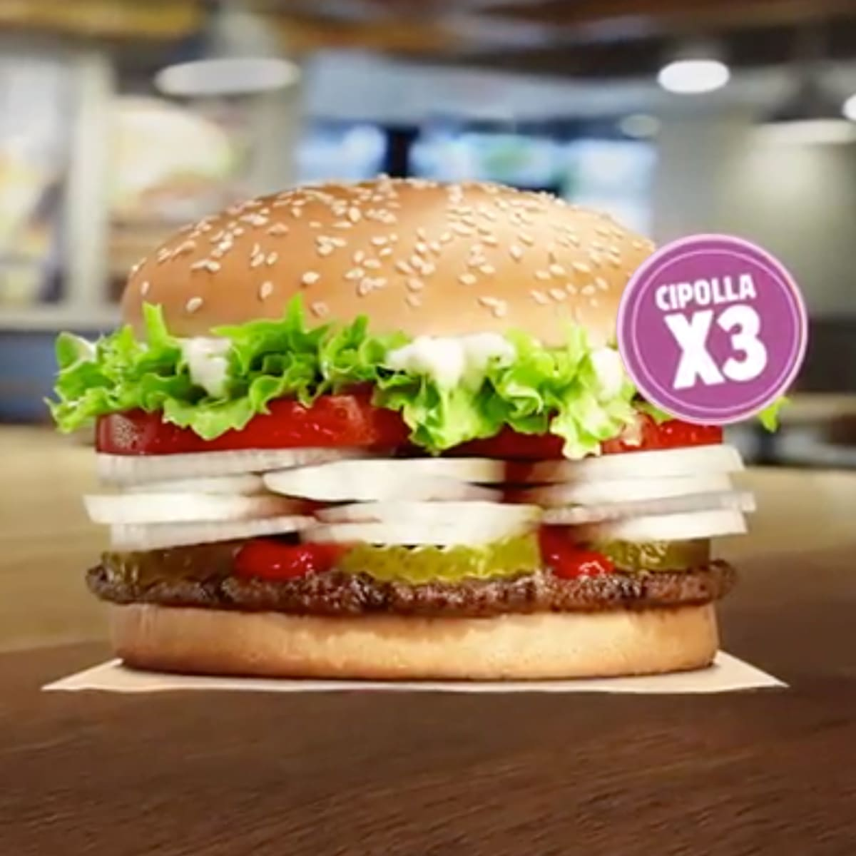 Burger King Whopper on wooden table
