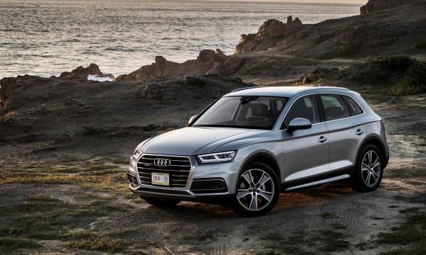 silver Audi car at coast scenery