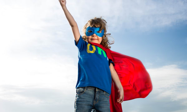 boy dressed up as Superman