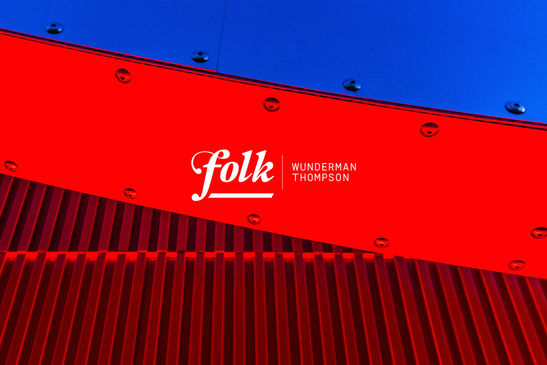 WT Folk logo on red and blue background